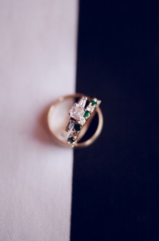 princess cut engagement ring with baggets and emerald green