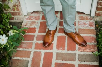 grooms legs in grey suit and brown ombre shoes