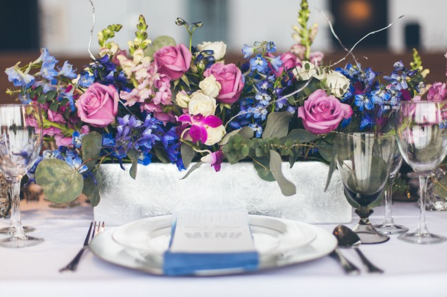 purple, blue, white, mauve and green floral bouquet centerpiece
