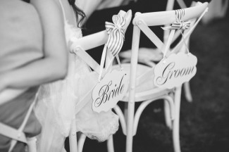 Bride and groom chair signs with stripped ribbon