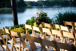 Wooden fold up wedding ceremony chairs beside water front
