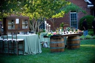 backyard wedding reception wine tasting bar with table on barrels