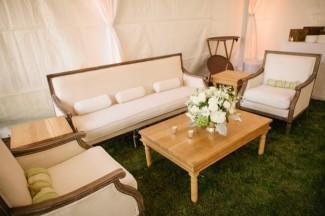 White furniture in backyard tent wedding