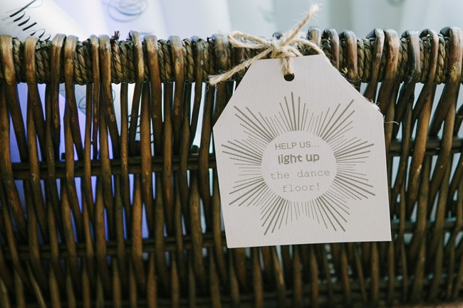 "basket with flow sticks and a sign that says ""help us light up the dance floor!"""