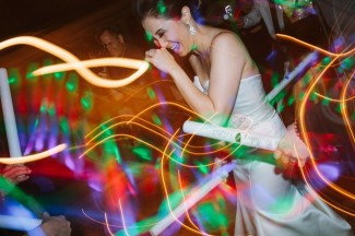 bride dancing at Arctic Club Hotel wedding with glow sticks