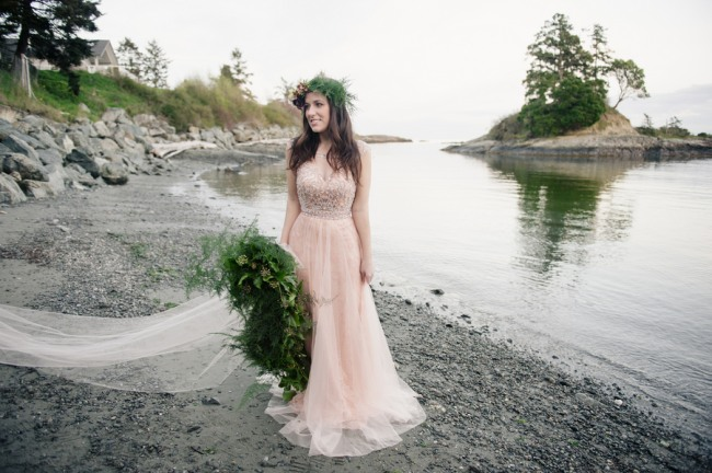 boho bride in pink dress on beach