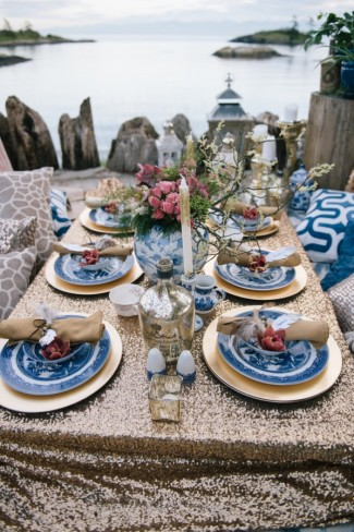 Picnic on Vancouver Island waterfront with gold sequin table cloth, throw pillows, gold chargers and Chinese style plates