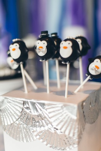 Penguin cake pops in white box decorated with silver cup cake liners