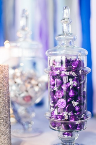 apothecary jar filled with purple Hershey kisses
