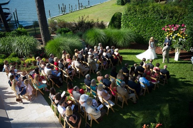 Outdoor grass wedding ceremony on lake front