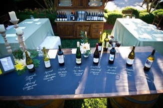 Outdoor wine tasting with chalkboard table top and wines lined up