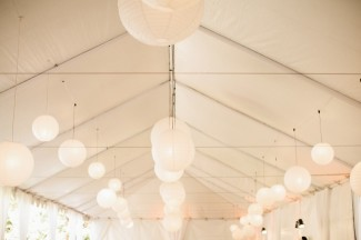 Whit tent for backyard wedding with white paper lanterns
