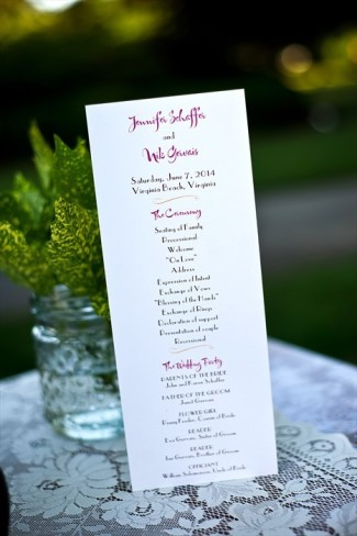 Red and black writing wine list for outdoor wedding reception tasting bar