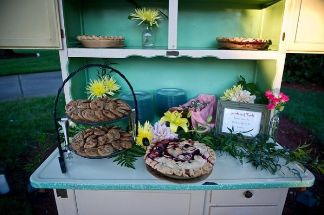 Old china cabinet with pies and dessert for backyard wedding repception