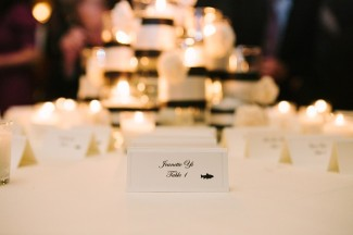 black and white escort card at Arctic Club Hotel wedding reception