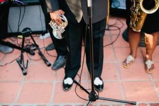 live band playing in backyard wedding with saxophone