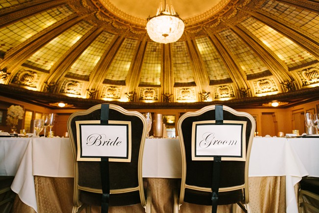 elegant black and gold chair signs saying bride and groom at Arctic Club Hotel wedding reception