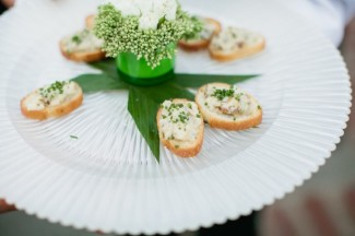 ribbed plate with cracker appetizers and green floral center piece