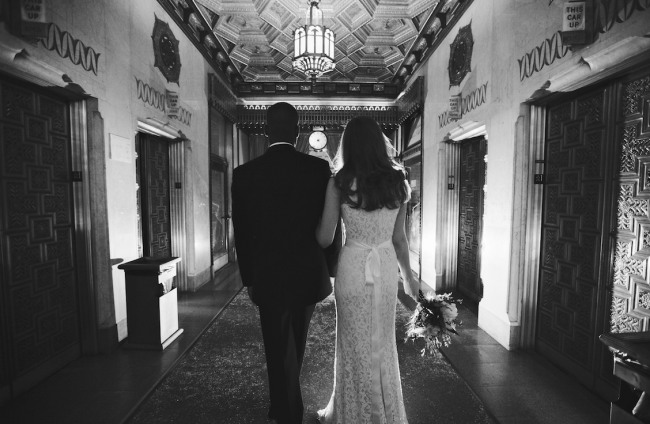 black and white photos of Bride and groom walking down hall of the Pittsfield Building