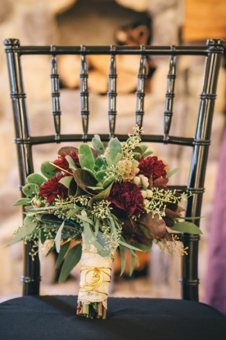vintage fall wedding inspiration shoot bouquet on chair