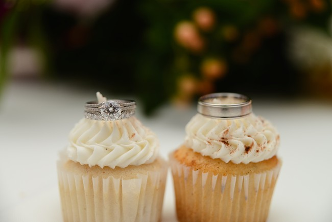 2 mini cupcakes with wedding bands place on top