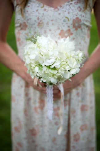 Bridesmaids carrying white hydrangea bouquet