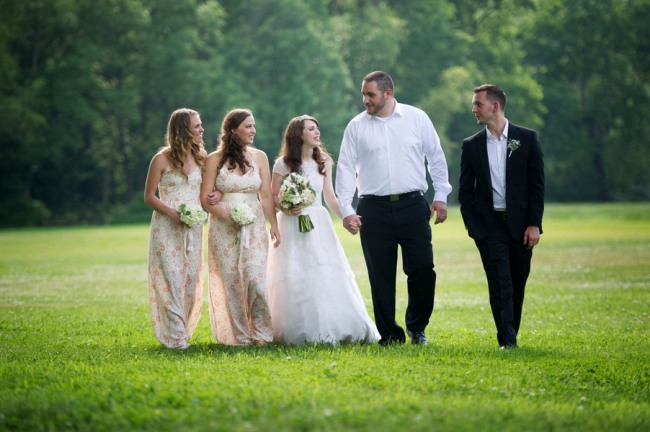 bride and groom walking with two bridesmaids and one groomsmen at Firestone Metro Park Wedding