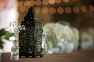 Black lantern and small mismatched vases with baby's breath at Firestone Metro Park Wedding