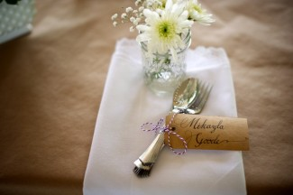 Paper table cloth, white napkin, small vase of white flowers at Firestone Metro Park Wedding