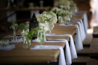 picnic table with white napkins, baby's breath, white hydrageas black lanterns at Firestone Metro Park Wedding
