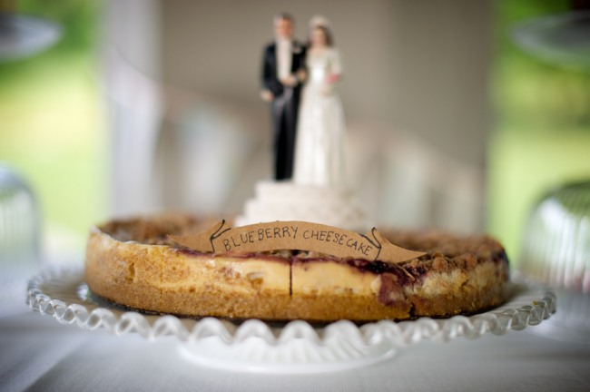 Blueberry cheesecake pie on cake stand with bride and groom on top at Firestone Metro Park Wedding