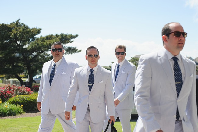 the groom and his guys in matching suits and sunglasses