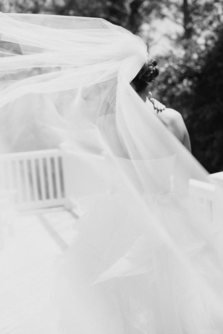 Black and white photo of a bridal veil blowing in the wind