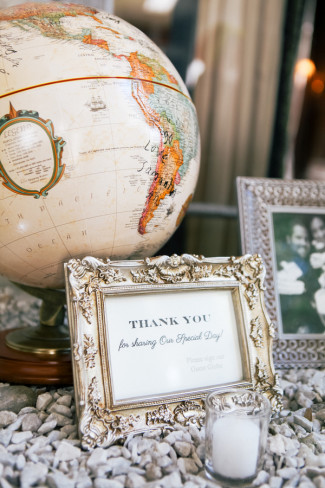Globe with silver frame and thank you sign for wedding guests