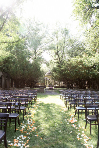 Outdoor wedding ceremony setup with brown chairs at Westchester Alder Manor House