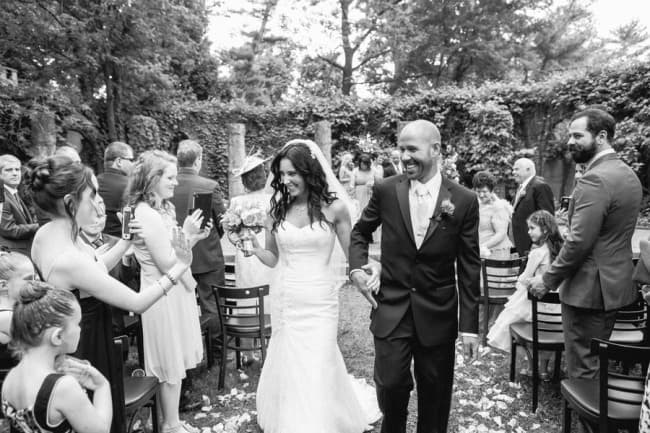Bride and groom recessional black and white photo