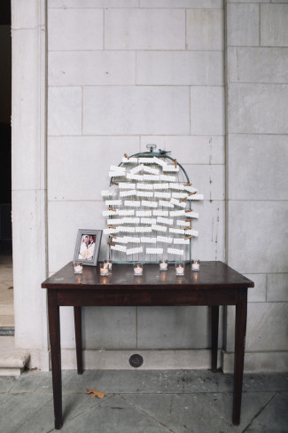Bird cage with escort cards for guests at Alder Manor House wedding