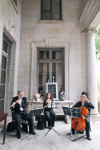 String trio playing during cocktail hour at Alder Manor House wedding