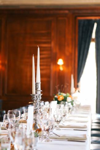 Silver candelabra on wedding reception table at Alder Manor House