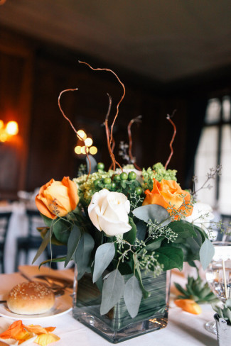 white and orange roses for floral center pieces at Alder Manor House wedding reception