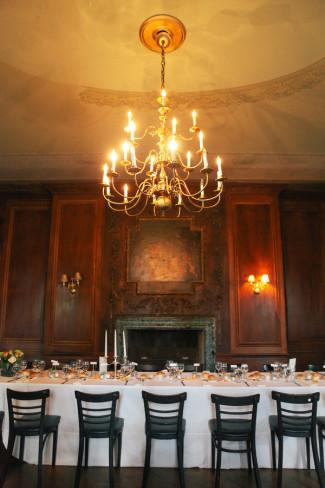 Large chandelier above wedding reception table at Alder Manor House