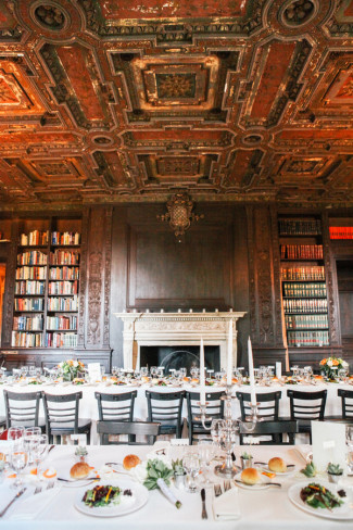 Wedding reception at Alder Manor House dining room with an ornate ceiling and fireplace