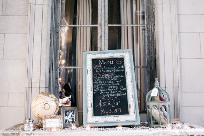 Wedding Menu chalkboard sign, bird cage for wedding guests cards and a globe on table