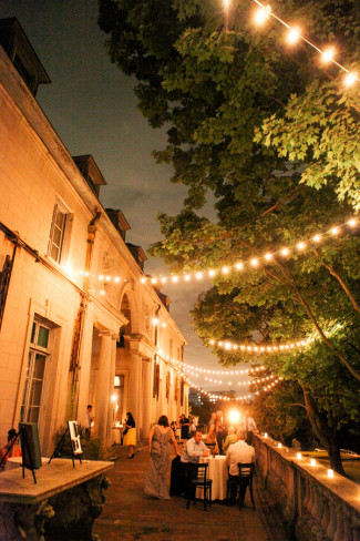 Wedding reception during the evening at Alder Manor House with small lights hanging and illuminating the area