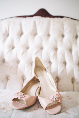 Low blush pink bridal peep toe heels with small cluster of flowers
