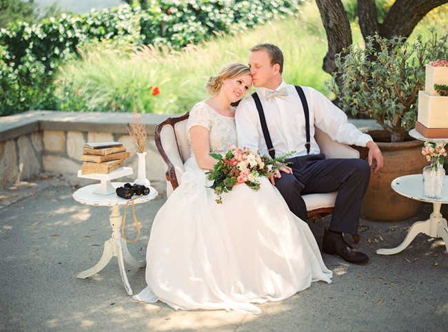bride and groom sit on vintage sofa outdoors