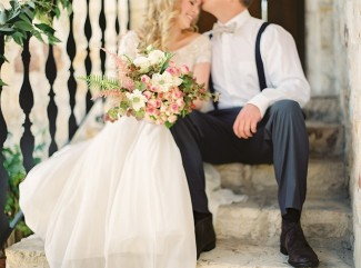 Bridal bouquet with bride and groom sitting on stairs