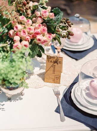 table card number with setting at whimsical woodland love styled shoot