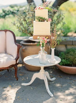 styled cake on white vintage table at Holman Ranch