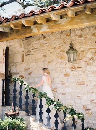 Bride walking up stairs at Holman Ranch